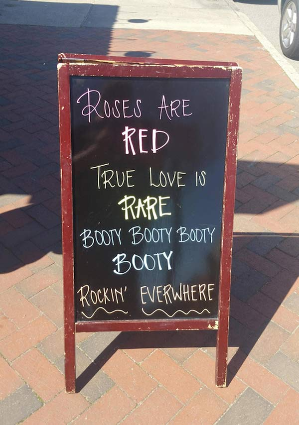 Funny sidewalk chalkboard signs: roses are red booty rocking' everywhere