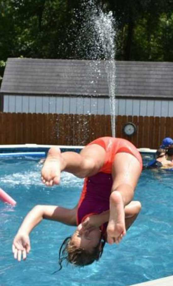 perfectly timed photos ~ jumping in pool, upside own with water shooting out of ass