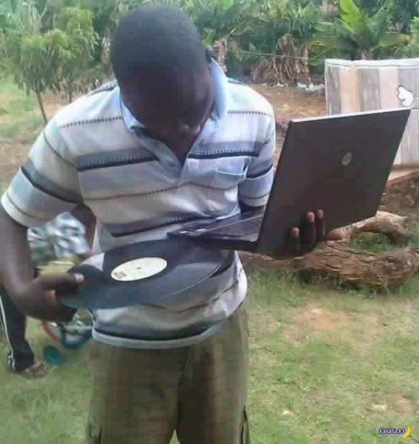 Funny pics ~ man trying to load a record LP into laptop