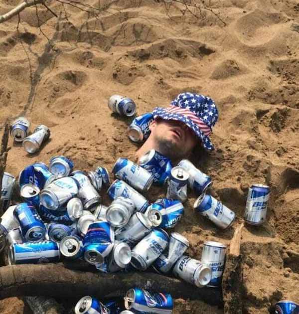 33 Funny Pics & Memes ~ passed out man buried at beach
