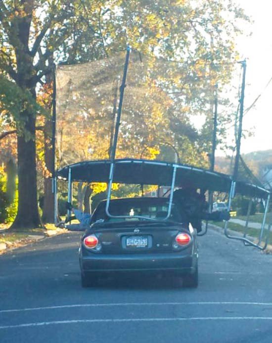 Funny Pics & Memes ~ redneck engineering, hauling trampoline on car roof