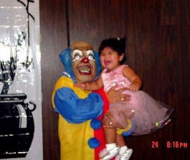 31 Funny Pics & Memes ~ creepy clown holding crying baby