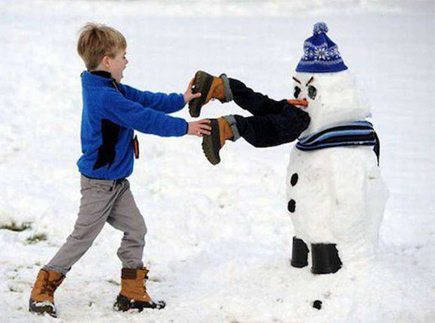 33 Funny Pics ~ snowman eating little boy