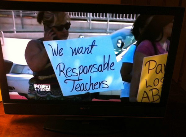31 Funny Pics & Memes ~ school demonstration, woman holding misspelled sign, responsible teachers