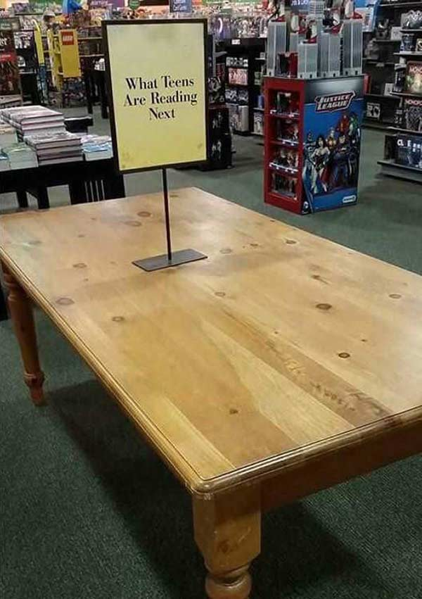 33 Funny Pics ~ bookstore sign on empty table what teens are reading next