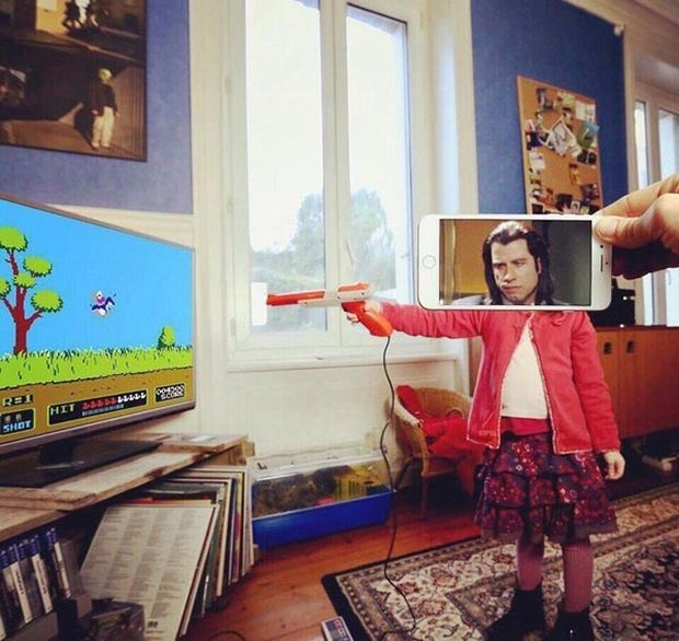33 Funny Pics ~ pulp fiction girl playing video shooter game trivolta