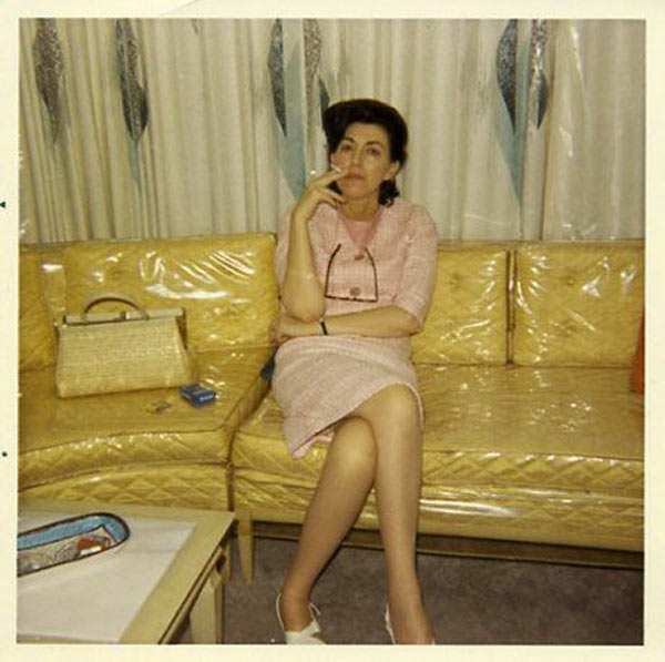 27 Funny Family Photos & Vintage Snaps ~ 1950's bound and determine to protect her sofa... plastic