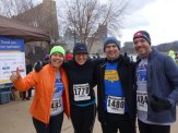 four smiling participants from the 2015 PH5k race