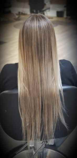 Hair client that got a color correction that is now medium blonde.