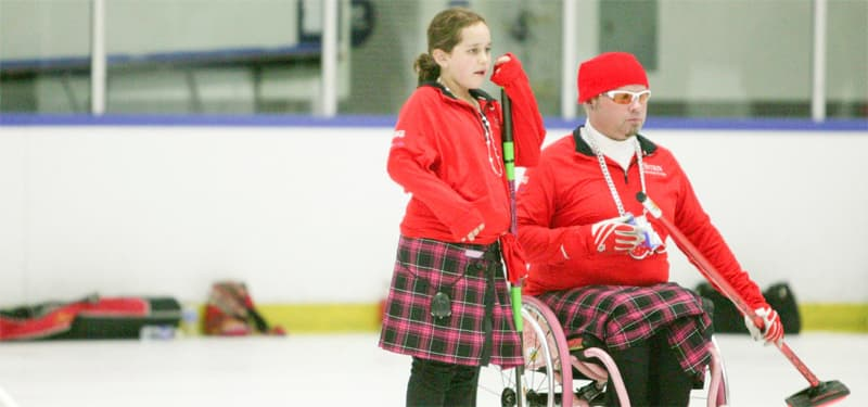 Patrick McDonald curls with his daughter