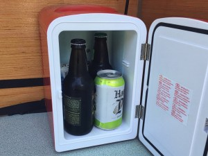 Photo of the interior of a beer cooler with bottles and cans