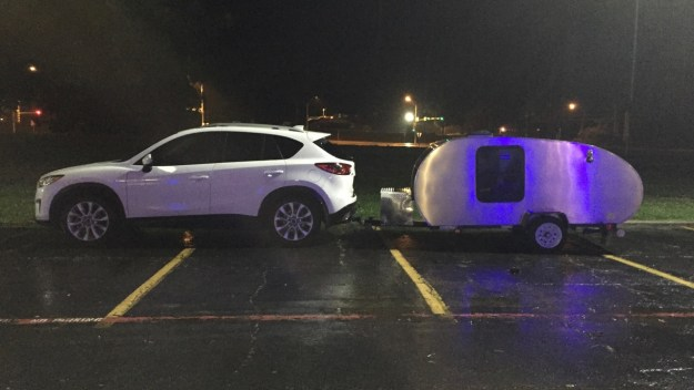 photo of car and trailer in the rain
