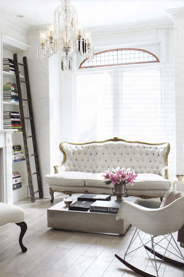 A Chandelier Adds A Touch of Sparkle to This Living Room