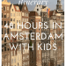 The ideal itinerary for 48 hours in Amsterdam with kids: image of houses on Damrak during pride week