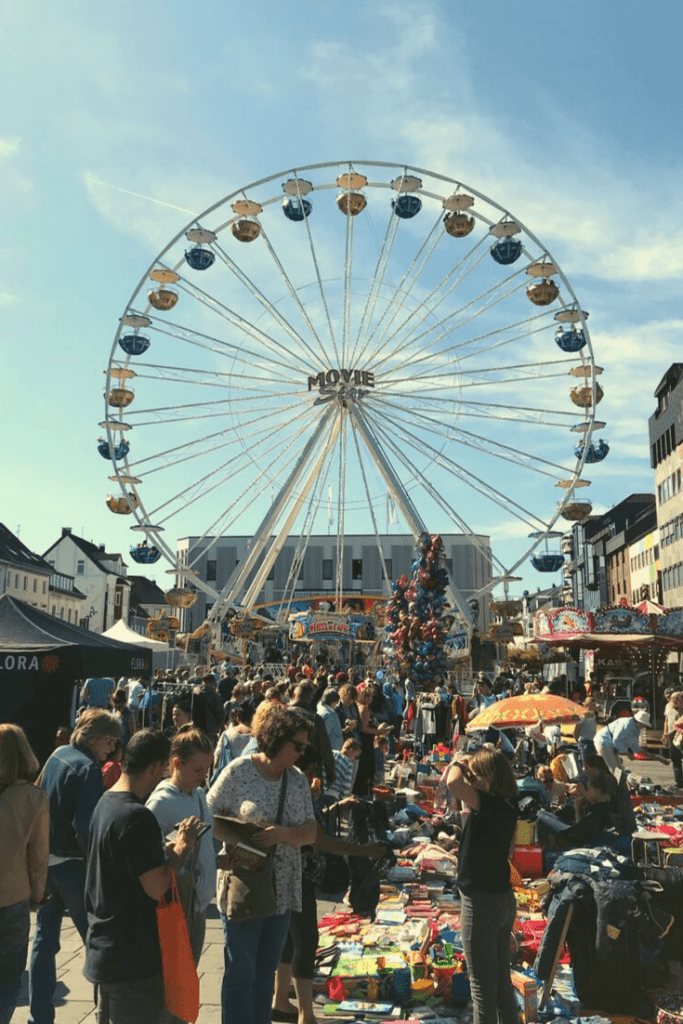 People enjoying the sun and the ferris wheel and searching for some flea market finds at the 2019 Zöppkesmarkt