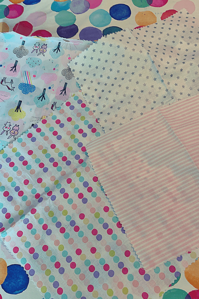 the four pieces of fabric chosen for our environmentally-friendly wax cloth food wraps: unicorn forest, colourful dots, silver stars and pink stripes