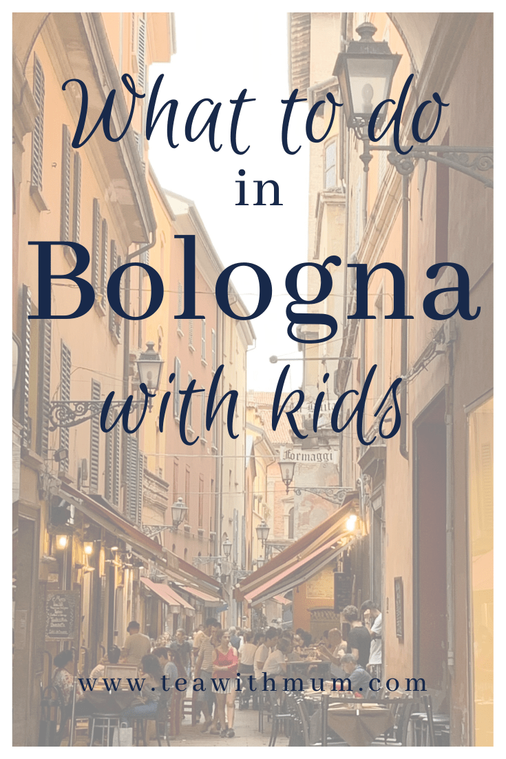 What to do in Bologna with kids; view of the start of the famous food streets in Bologna, just off Piazza Maggiore