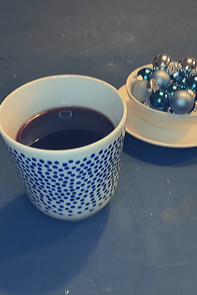 Glühwein or German mulled wine is a favourite at German Christmas markets - Mug of Glühwein with blue gall baubles