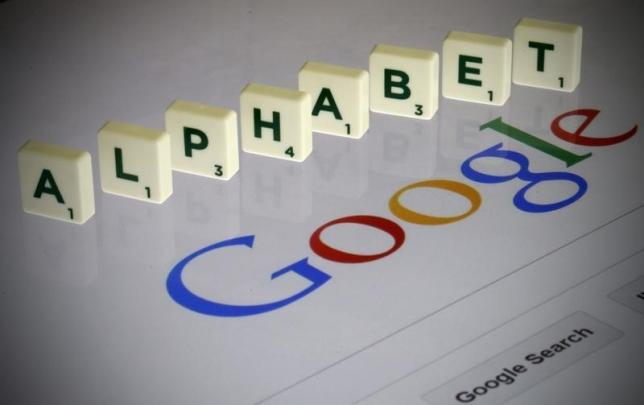 """Letters spell the word """"Alphabet"""" as they are seen on a computer screen with a Google search page in this photo illustration taken in Paris"""