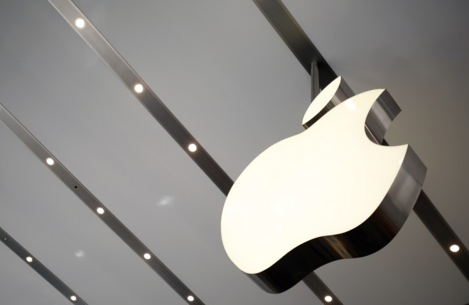 Apple logo is pictured inside the newly opened Omotesando Apple store at a shopping district in Tokyo