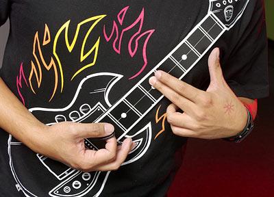ThinkGeek's Electronic Rock Guitar Shirt