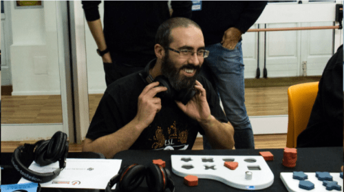 Man wearing headphones using the KIBO musical instrument