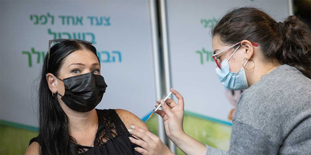 Why Thousands Of Vaccinated Israelis Got COVID-19 Anyway