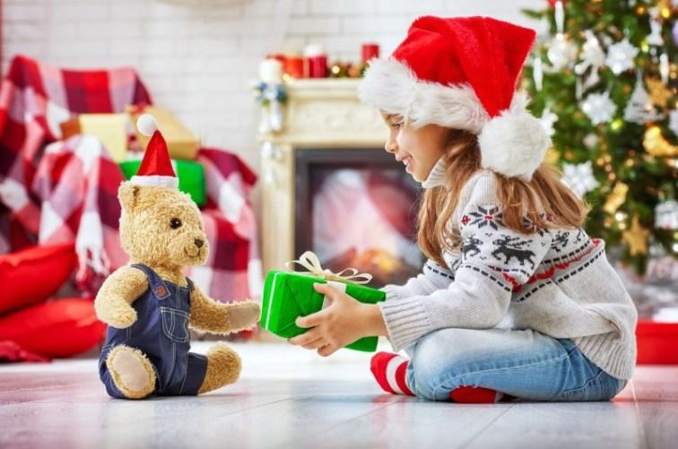 Christmas Child Santa Giving Gift to Teddy Bear