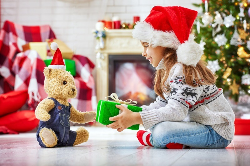 Christmas Child Santa Giving Gift to Teddy Bear