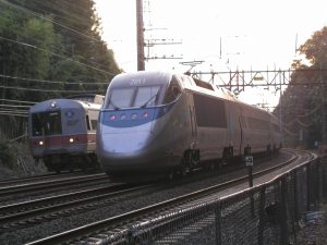 Acela Express rounds a curve in Connecticut