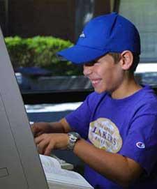 disturbingly_pleased_kid_computer.jpg
