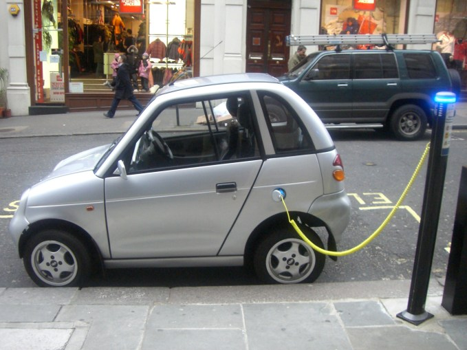 The REVAi/G-Wiz i electric car charging at an on-street station in London