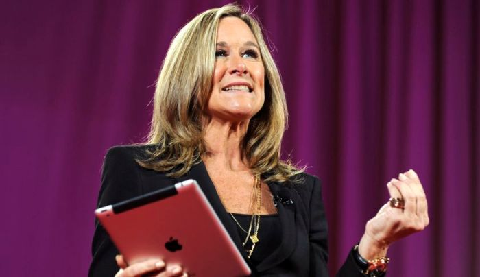 FILE PHOTO: Angela Ahrendts, chief executive officer of Burberry Group Plc, speaks as she holds an Apple Inc. iPad at the 2011 World Business Forum in New York, U.S., on Wednesday, Oct. 5, 2011. Burberry Group said Christopher Bailey will become chief executive officer of the largest British luxury-goods producer, as CEO Angela Ahrendts departs the company to work at Apple Inc. Photographer: Peter Foley/Bloomberg via Getty Images