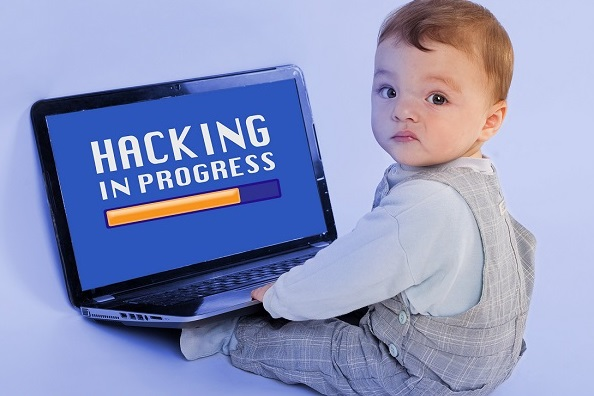 Funny image about the younges hacker in the world - Adorable baby sitting in front of the laptop and hacking.