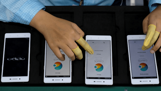 Oppo-smartphone-worker-testing-Reuters-720