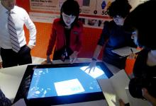 Touch a fancy new screen at DBS' new NUS outlet