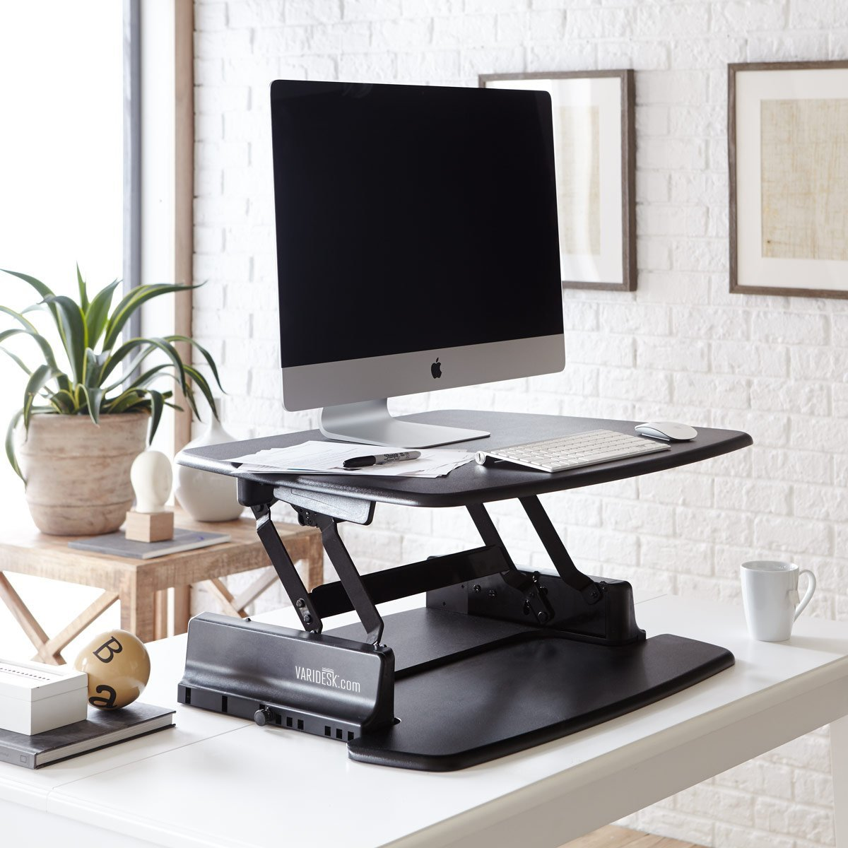 this standing desk is a little more involved than the 3 desk on our list and it costs a bit more as a result