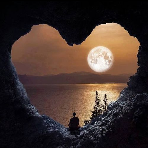 cave in the form of heart with a view to the moon