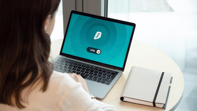 Woman Using Laptop with VPN
