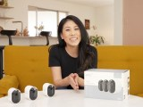 Nicki Sun sitting in her home with the Arlo Pro 4 cameras.
