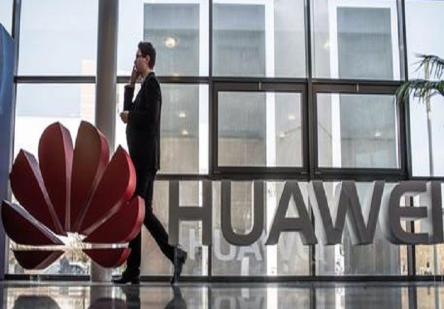 epa04687418 (FILE) A file photo dated 17 March 2015 mshowing a man walking past a Huawei logo at the world's biggest computer fair CeBIT CeBIT in Hanover, Germany. Chinese telecom giant Huawei increased its profits by 32.7 per cent last year, the company announced 31 March 2015. Net profits reached 27.9 billion yuan (4.5 billion dollars) in 2014, as the world's second-largest telecommunications equipment maker benefited from robust smartphone sales and upgrades to faster mobile data networks. Revenues of the Shenzhen-based company rose 20.6 per cent year-on-year, to 288.2 billion yuan.  EPA/OLE SPATA