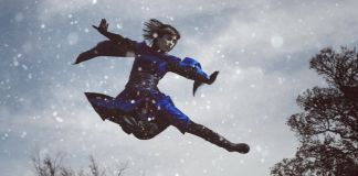 A man flying through the air while riding skis