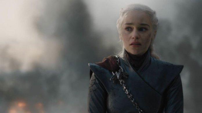 Emilia Clarke standing next to a dock