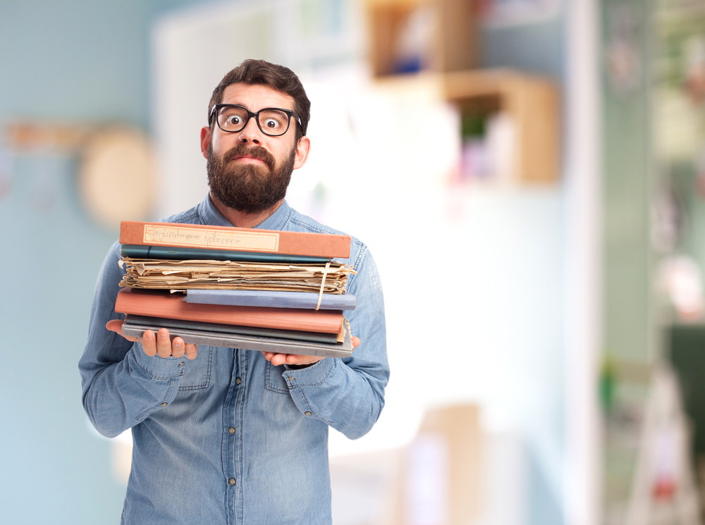 Man with burden of files