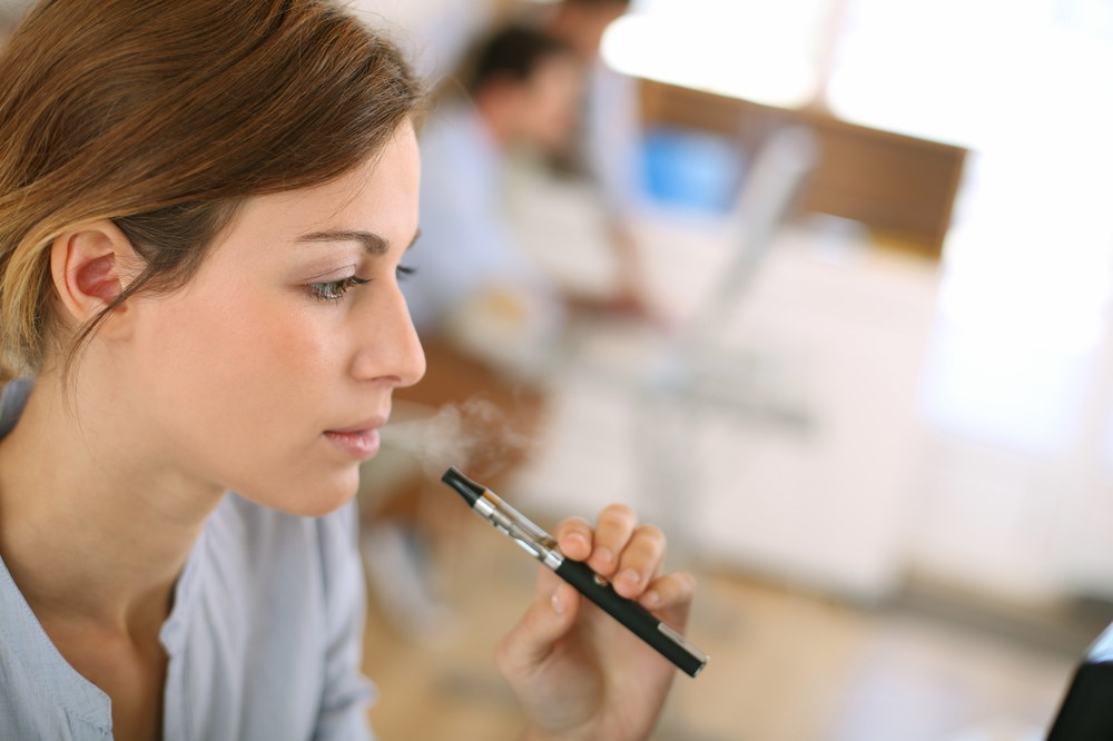 woman smoking with e-cigarettes