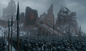 The Targaryen flag flies over the ash-strewn ruins of King's Landing.