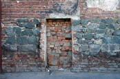 Image of a bricked-up doorway