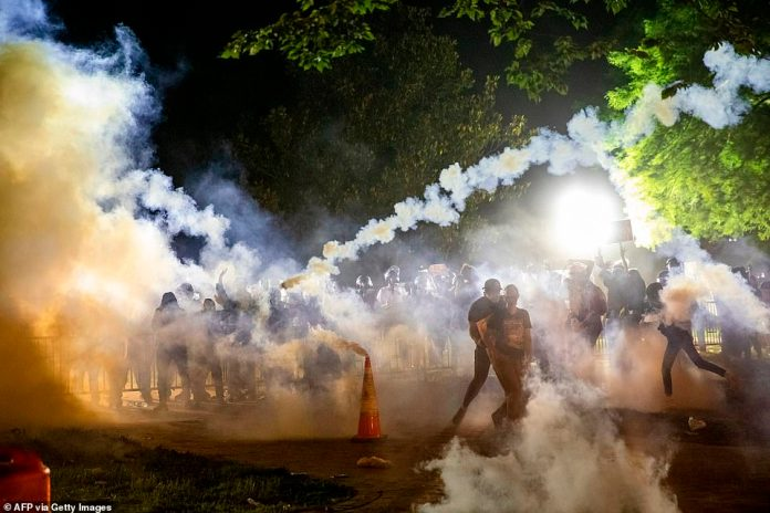 WASHINGTON DC: Chaos continued to unfold in cities across America late Sunday night including Washington DC, just steps from the White House, where police and Secret Service deployed tear gas as they faced off with protesters during a demonstration over the death of George Floyd