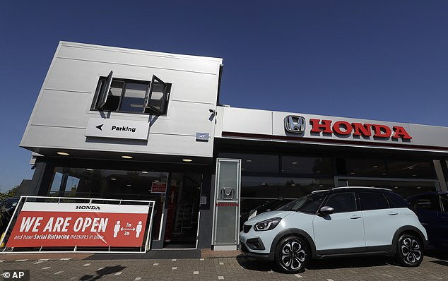 Open for business: Car showrooms have been allowed to serve customers from today as part of the latest phase of easing lockdown and kick-starting the economy