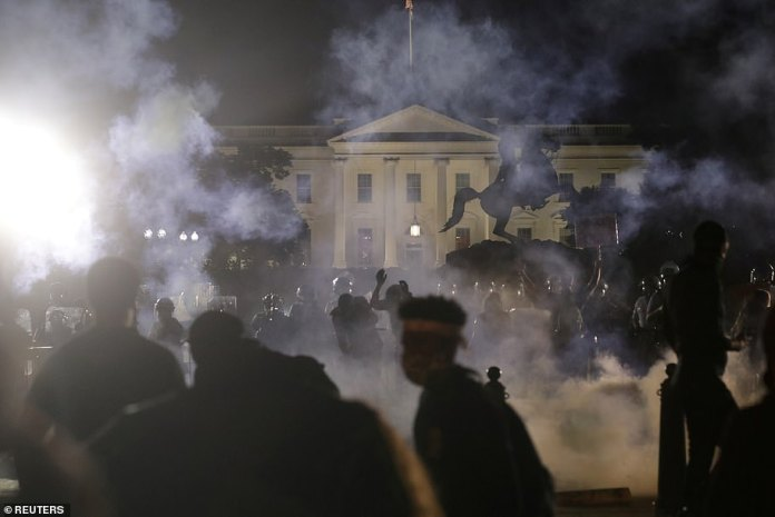 Trump advisers are reportedly worried that the president's tone could alienate independent voters. The image above shows protesters outside the White House late on Sunday night